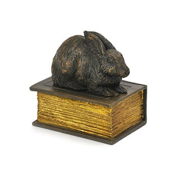 pet urns rabbit on a book